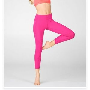 Fabletics mid rise pureluxe ruched legging. Pink